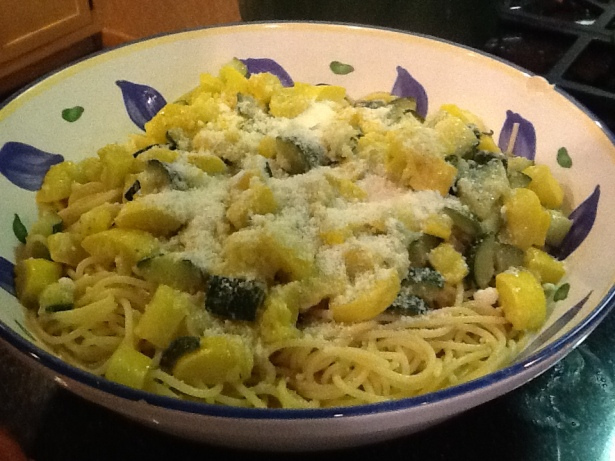 zucchini pasta in bowl with cheese